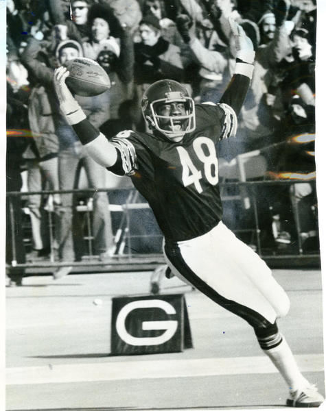 Allan Ellis celebrates a touchdown he scored on an interception return.