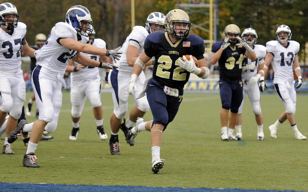 Hartford, CT 10/27/12 Evan Bunker scored 2 TD's, including this one from 11 yards, to help the Bantams defeat Middlebury 45-7 at Jesse/MIller FIeld in Hartford on the Trinity campus Saturday afternoon. The Bantams improved to 6-0 handing Middlebury their first loss of the season and continued the nations longest home winning streak at 46 games. Photo by JOHN WOIKE | woike@courant.com