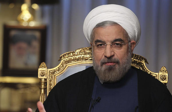 Iranian President Hasan Rouhani speaks during an interview with state television in Tehran, Iran.