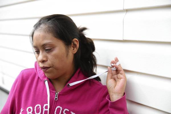 Imelda Alanis speaks about her brother-in-law Gustavo Briceno outside the Briceno family's home in Glendale Heights on Thursday. Briceno was killed Wednesday when a surge of rainwater swept him away while he was working in a sewer on the Northwest Side.