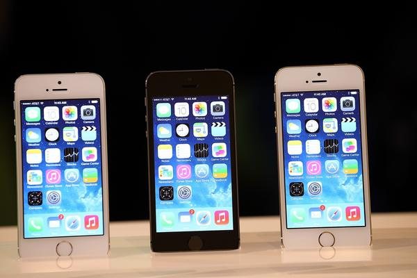 The new iPhone 5s is displayed during an Apple product announcement.