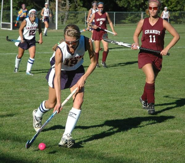 Avon senior Caroline Schaefer dribbles the ball down the field in the second half of a field hockey game Thursday between Granby and Avon. Avon won 2-0 and Schaefer scored a second-half goal.