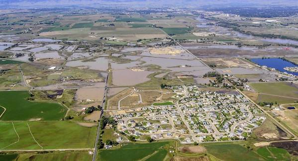 An image captured Tuesday shows flooding in Colorado's Weld County, where two large oil spills have resulted from inundated drilling and storage facilities.