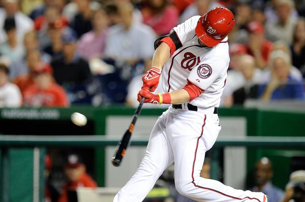 WASHINGTON, DC - SEPTEMBER 19: Bryce Harper #34 of the Washington Nationals hits a home run in the first inning against the Miami Marlins at Nationals Park on September 19, 2013 in Washington, DC. (Photo by Greg Fiume/Getty Images)