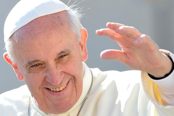 Pope Francis waves to the crowd as he arrives for his general audience in St Peter's square at the Vatican on Wednesday.