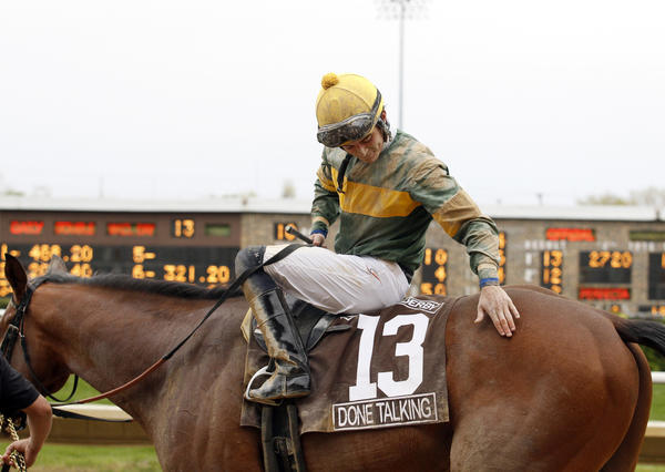 Jockey Sheldon Russell pats Done Talking after rhey came in first place in the 2012 Illinois Derby at Hawthorne.