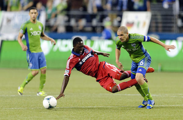 Fire midfielder Patrick Nyarko tries to tackle Seattle's Osvaldo Alonso during the 2nd half at CenturyLink Field.