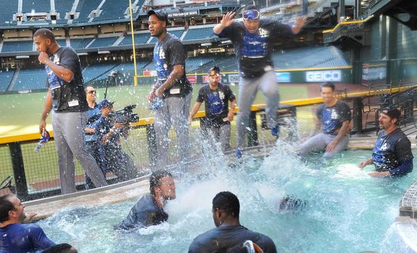 The Dodgers' Hyun-Jin Ryu jumps into the pool to join his teammates after defeating the Diamondbacks to clinch the NL West.