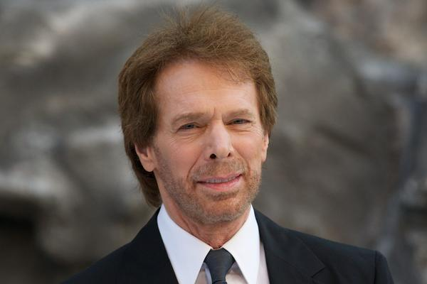 "Jerry Bruckheimer poses for pictures at the UK premiere of ""The Lone Ranger."""
