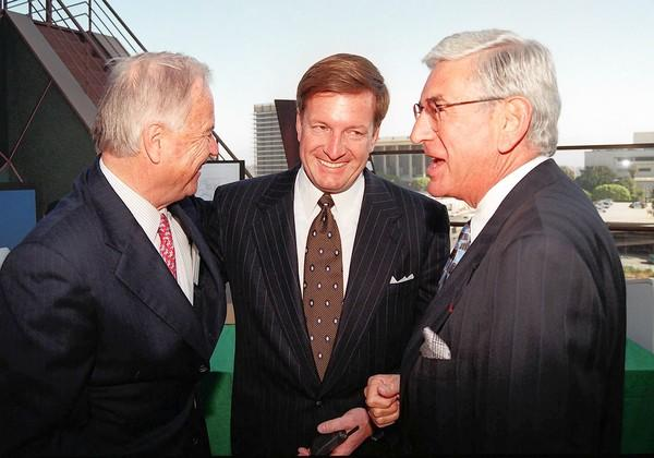 In a 1997 photo, Los Angeles Mayor Richard Riordan, left, talks with Ron Burkle, center, and Eli Broad after a $15-million gift was donated to the Walt Disney Concert Hall project.