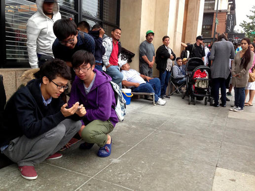 People line up Friday morning outside the Apple Store in Pasadena waiting for the opportunity to purchase a new iPhone 5s and 5c.