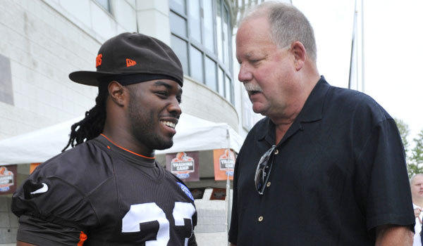 Former Cleveland Browns president Mike Holmgren, right, talks with running back Trent Richardson at training camp this summer. Richardson was traded to the Indianapolis Colts this week.