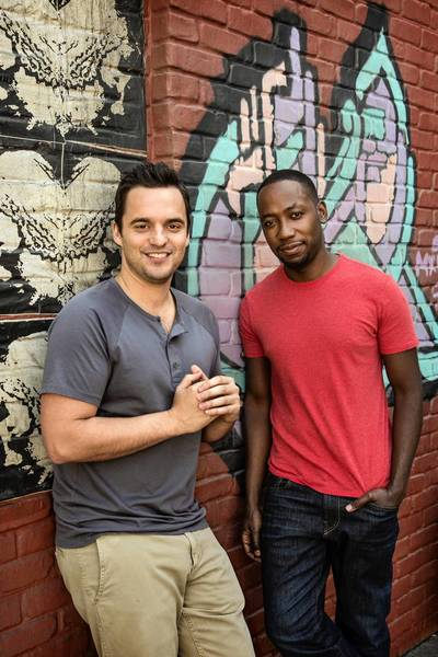 "Jake Johnson and Lamorne Morris on the set of ""New Girl."""