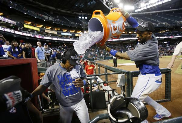 Sep 19, 2013; Phoenix, AZ, USA; Los Angeles Dodgers center fielder Matt Kemp (right) dumps gatorade on Hanley Ramirez (left) after defeating the Arizona Diamondbacks 7-6 to clinch the NL West title at Chase Field.