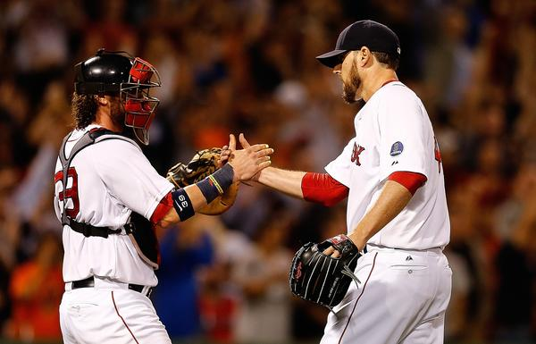 BOSTON, MA - SEPTEMBER 19: John Lackey #41 of the Boston Red Sox celebrates with Jarrod Saltalamacchia #39 after pitching a two-hit complete game against the Baltimore Orioles to clinch a playoff position at Fenway Park on September 19, 2013 in Boston, Massachusetts.