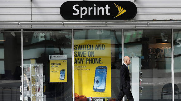 A pedestrian passes a Sprint store in San Francisco in April.