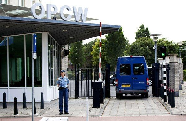 United Nations weapons inspectors arrive at the Organization for the Prohibition of Chemical Weapons headquarters in The Hague.