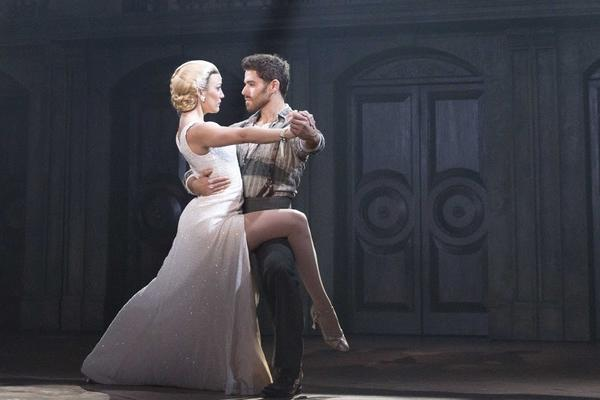 "Caroline Bowman as Eva Peron and Josh Young as Che in ""Evita."""