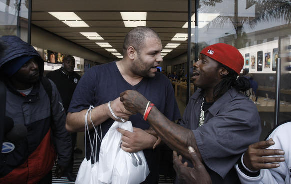 Two men argue outside the Apple Store in Pasadena over what officials said was a dispute stemming from a deal for one to buy a new iPhone for the other.
