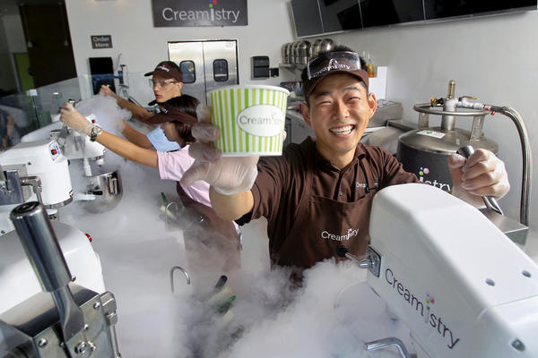 Owner Jay Yim, 33, right, of Yorba Linda poses for a portrait at Creamistry in Irvine on Thursday. Creamistry is the first liquid nitrogen ice cream shop in Orange County.