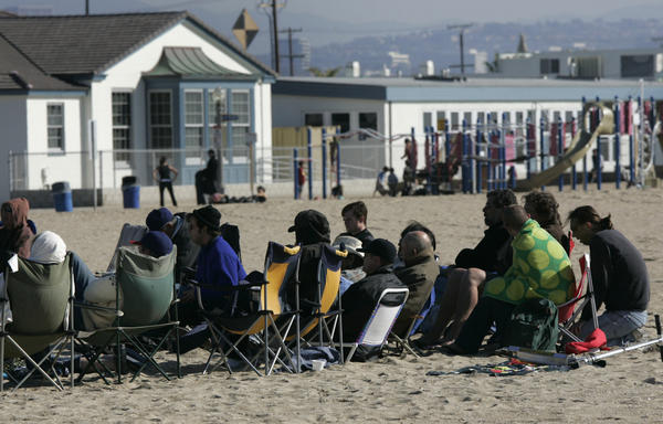 A recovery group meets on the sand in Newport Beach in 2007. The city's effort to curb sober-living group homes with a 2008 ordinance might be discriminatory, a federal appeals court panel decided Friday.