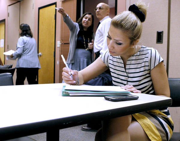 Masha Khodabakhshi, 34 of Woodland Hills, fills out a Vons job application at the Verdugo Jobs Center in Glendale during the summer
