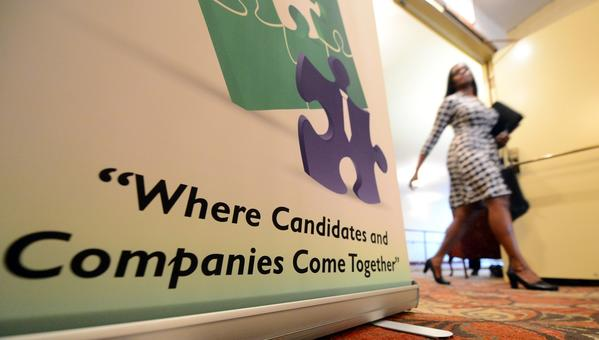 The unemployment rate in California ticked up for the second month in a row, rising to 8.9% from 8.7% the month before. Above, a woman attends a job fair in Arcadia last month.