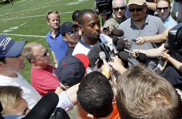 Running back Willis McGahee talks with reporters after Denver's mandatory mini-camp in June, two days before being released by the team.