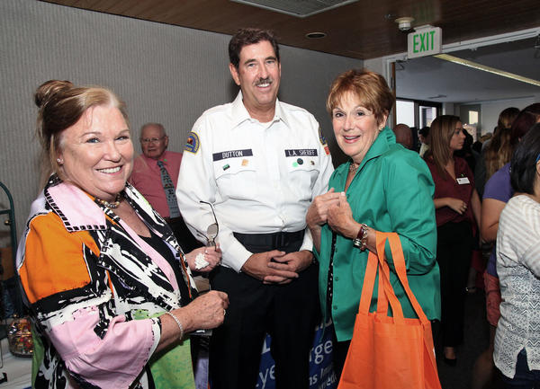 Sheriff's Community Assistance Volunteer Paul Dutton talks with Dr. Dorothy Beeve and Laurie Herbert. Community members from Montrose-Verdugo City, Crescenta Valley & La Cañada Flintridge Chamber of Commerce mingle, taste food, and see what local vendors have to offer during this years Expo held at Verdugo Hills Hospital on Wednesday, Sept. 18, 2013.