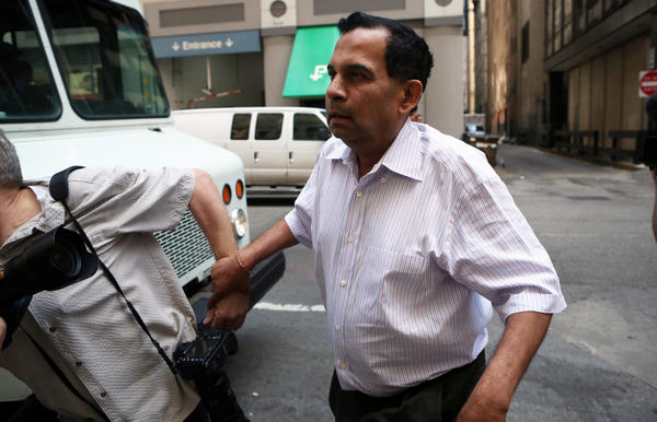 Raghuveer Nayak tries to evade the media after a 2012 hearing.