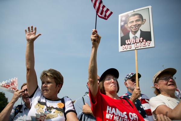 "Tea party activists cheer during the ""Exempt America from Obamacare"" rally Sept. 10 on Capitol Hill."