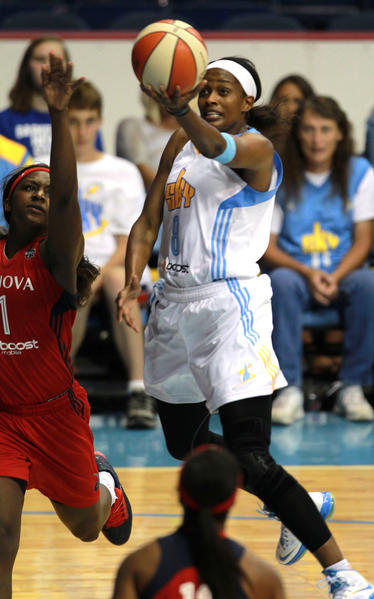 Sky guard Swin Cash floats through the lane and lays in a basket in July.