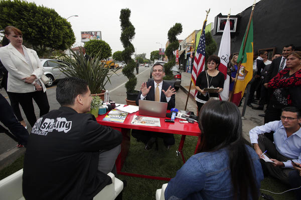"Los Angeles Mayor Eric Garcetti meets Armando Gonzalez, 39, and Leslie Baez, 20, of Soul Skating at his ""help desk"" temporarily set up on 1842 E. 1st St. in Boyle Heights."