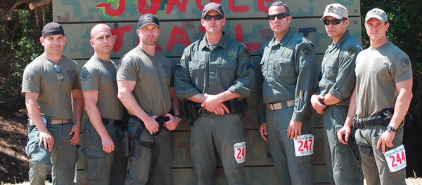 Members of the Glendale Police Departments Special Weapons and Tactics team pose in front of the Jungle Trail at the 2013 Santa Clara County Sheriffs Best of the West invitational SWAT competition.