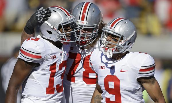 Ohio State's Kenny Guiton, left, Andrew Norwell, center, and Devin Smith celebrate a touchdown against California on Saturday. Expect to see plenty of scoring celebrations by the Buckeyes this week.