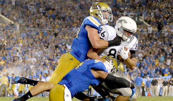 UCLA's Jordan Zumwalt, left, and Anthony Barr, center, tackle Nevada's Kolby Arendse on Aug. 31, 2013.