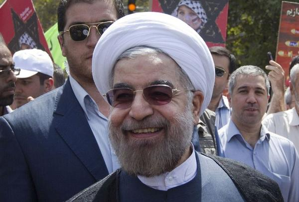 Iranians and Americans hopeful of better relations between their two countries will be closely following the visit next week to the U.N. General Assembly of Iranian President Hassan Rouhani, center, who has turned a more pleasant face to the West since his inauguration last month.