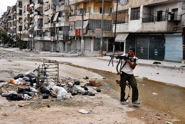 A Syrian rebel fires at pro-government forces in Aleppo.