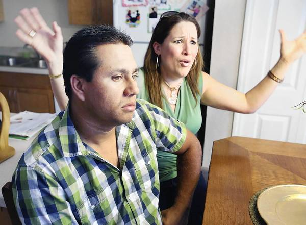 Alberto Gutierrez and his wife Jacqueline Ferrer talk about their nightmare ordeal of being conned and defrauded of thousands of dollars by a woman who was claiming to help them with immigration issues. The couple is pictured at their Altamonte Springs home on Thursday, September 19, 2013.