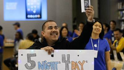 Apple loyalists line up to buy newest iPhones