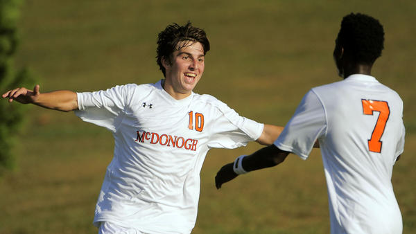 McDonogh's Connor Smith celebrates his team's first goal with Nick Brown (7).