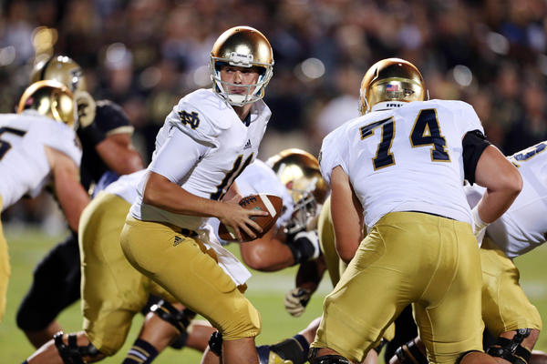 Notre Dame quarterback Tommy Rees hands the ball off against Purdue.