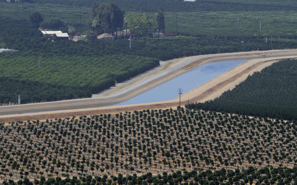 Water in a concrete lined canal flows past citrus and nut tree groves near Exeter. Nearly 20% of all groundwater withdrawals in the United States occur in California.