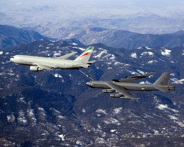 This Boeing handout image received 12 February, 2007 shows a Boeing KC-767 Tanker(L) extending its boom successfully with a B-52 aircraft in January 2007 during a test flight.