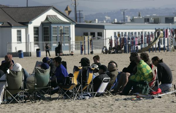 A rehab group meets on the beach in Newport Beach. Newport Beach passed an ordinance limiting group homes for recovering addicts after residents complained that dozens of group homes had created parking, traffic, noise and secondhand smoke problems in residential neighborhoods.
