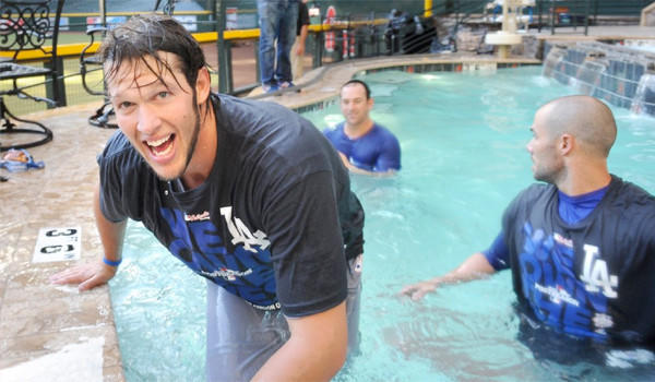 Clayton Kershaw and his Dodgers teammates celebrate clinching the National League West title with a dip in the Arizona Diamondbacks pool, a move criticized by Sen. John McCain (R-Ariz) among others.