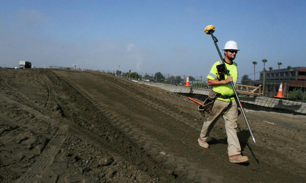A crew member prepares for a 20-hour closure on the new Seal Beach bridge and the 405 Freeway in Orange County in August.