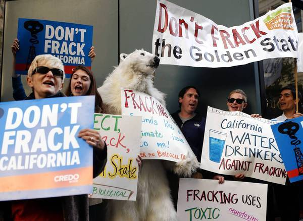 Demonstrators in San Francisco earlier this month protest California Gov. Jerry Brown's position on fracking. Most environmental groups wanted Brown to veto a fracking bill he signed Friday, saying it did not go far enough to protect the environment.