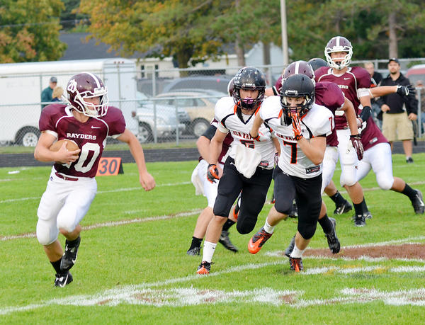 Charlevoix's Sam Hovie (20) looks for running room around the right side in the first half of the Rayders' game against Elk Rapids at Kipke Field on Friday, Sept. 20.
