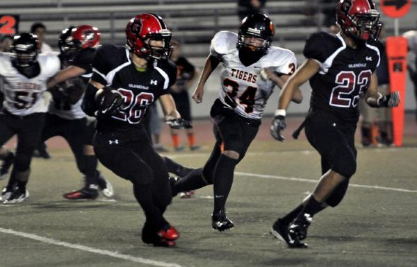 Glendale High running back Daniel Jung rushed for over 115 yards and a touchdown during the Nitros 23-7 nonleague win over South Pasadena High on Friday night. (Mike Mullen)